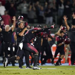 San Diego State players and staff celebrate a 33-31 win in triple overtime against Utah in an NCAA college football game Saturday, Sept. 18, 2021, in Carson, Calif.