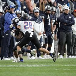 BYU running back Tyler Allgeier gets tackled by Boise State's Kekaula Kaniho during an NCAA college football game at LaVell Edwards Stadium in Provo on Saturday, Oct. 9, 2021.