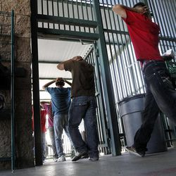 Illegal immigrants prepare to enter a bus after being processed at Tucson Sector U.S. Border Patrol Headquarters Thursday, Aug. 9, 2012, in Tucson, Ariz.  New strategies being implemented by the U.S. government, including the halting of one-way flights back to the interior cities in Mexico, are in place to streamline processing and expedite a return to Mexico.