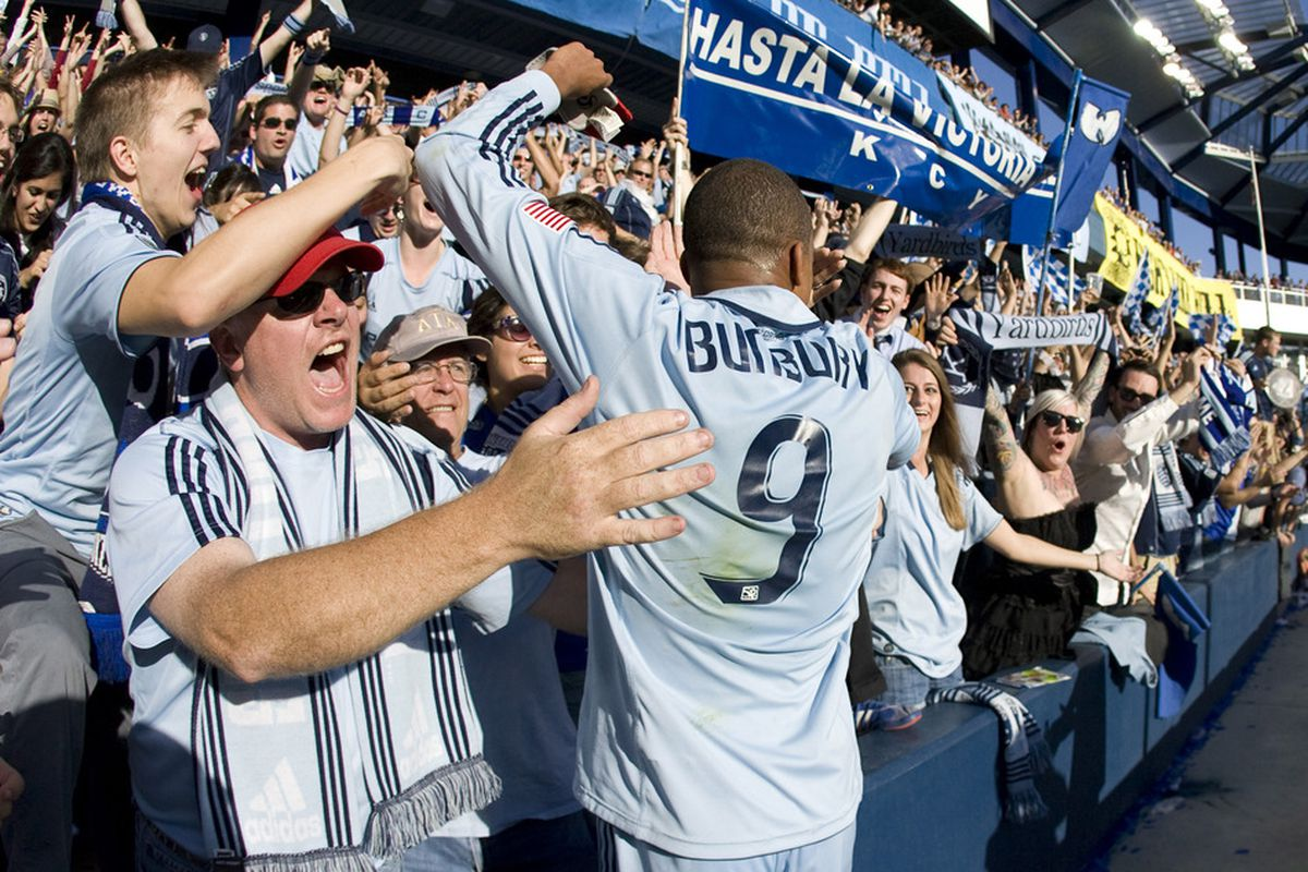 KANSAS CITY, KS - OCTOBER 15: Teal Bunbury #9 of Sporting Kansas City celebrates with fans a 2-0 win over the New York Red Bulls at Livestrong Sporting Park on October 15, 2011 in Kansas City, Kansas. (Photo by Ed Zurga/Getty Images)