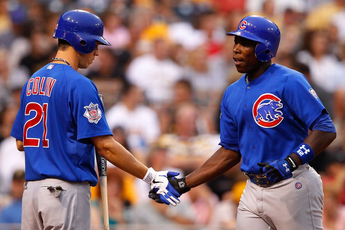 Alfonso Soriano of the Chicago Cubs is congratulated by teammate Tyler Colvin after hitting a solo home run against the Pittsburgh Pirates during a game at PNC Park in Pittsburgh, Pennsylvania.  (Photo by Jared Wickerham/Getty Images)