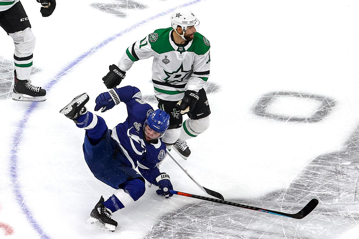 Tyler Johnson #9 of the Tampa Bay Lightning gets tripped up against Andrew Cogliano #11 of the Dallas Stars during the first period in Game Two of the 2020 NHL Stanley Cup Final at Rogers Place on September 21, 2020 in Edmonton, Alberta, Canada.