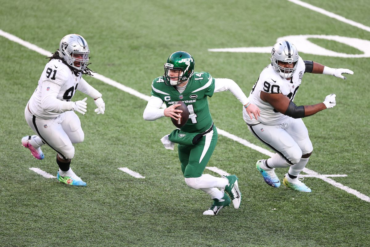Sam Darnold #14 of the New York Jets in action against the Las Vegas Raiders during their game at MetLife Stadium on December 06, 2020 in East Rutherford, New Jersey.