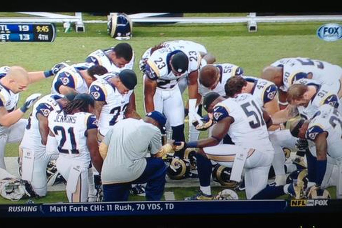 """St. Louis Rams players pray for injured LT Rodger Saffold. Photo via <a href=""""https://twitter.com/ThePigskinArch"""" target=""""new"""">@ThePigskinArch</a>."""