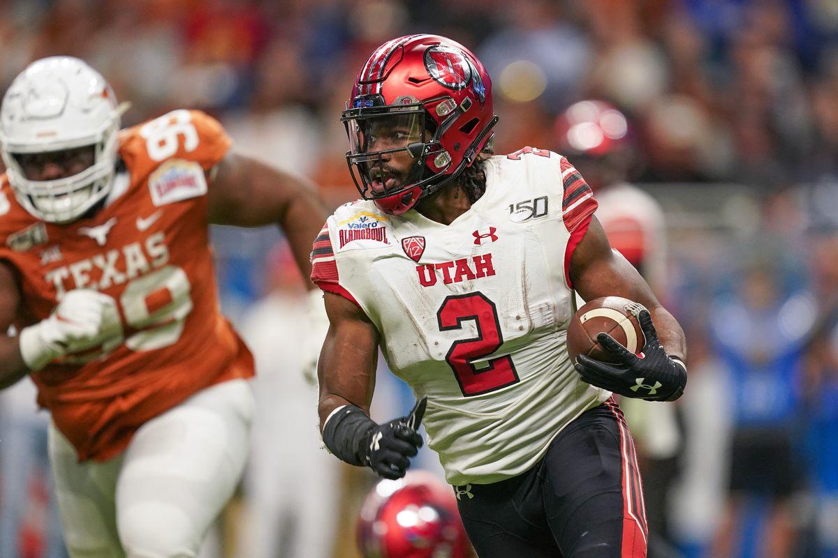 Utah Utes running back Zack Moss runs the ball as Texas Longhorns defensive lineman Keondre Coburn pursues during the second half at the Alamodome.