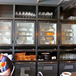 Five of the seven total refrigerators, fully stocked with cheeses from all over America