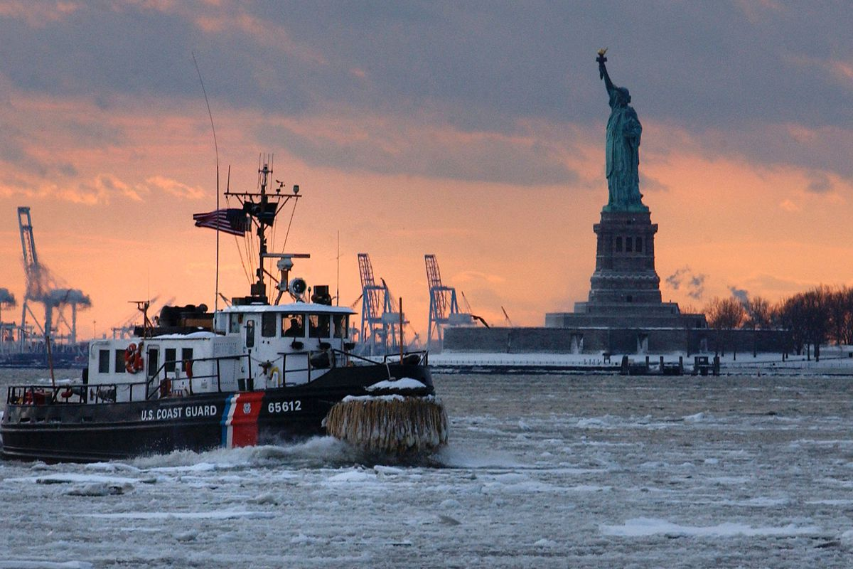 U.S. Coast Guard Tugboat Deals With Ice In New York Harbor
