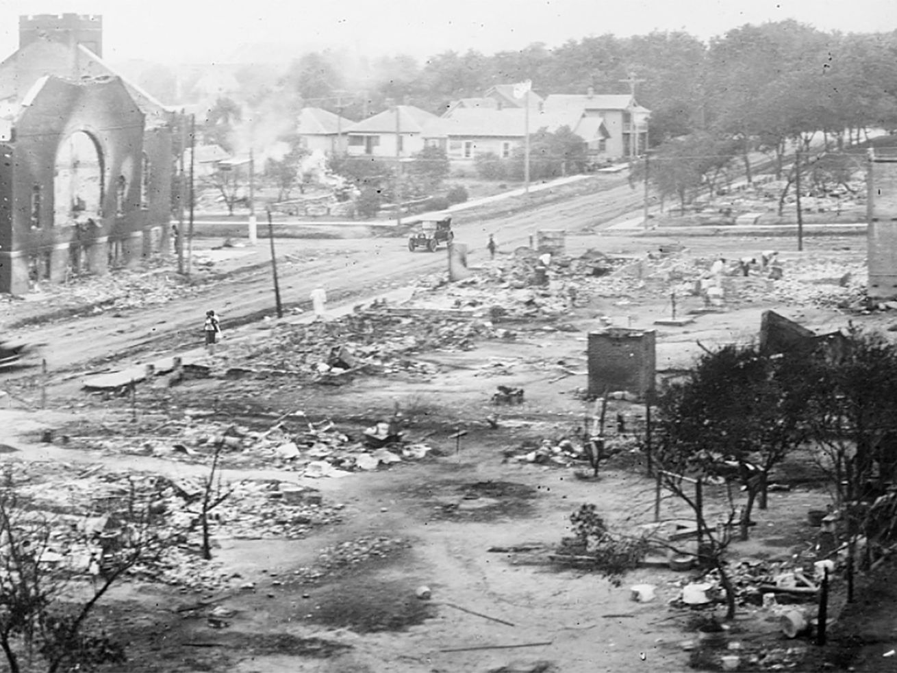 This June 1921 photo shows the aftermath of the the Tulsa Race Massacre in Tulsa, Oklahoma. -