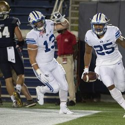 BYU's Tyler Allgeier (25) reacts after scoring a touchdown during the first half of an NCAA college football game against Navy, Monday, Sept. 7, 2020, in Annapolis, Md.