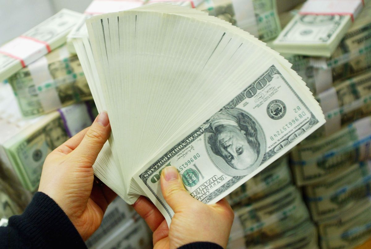 A person holds a lot of cash.