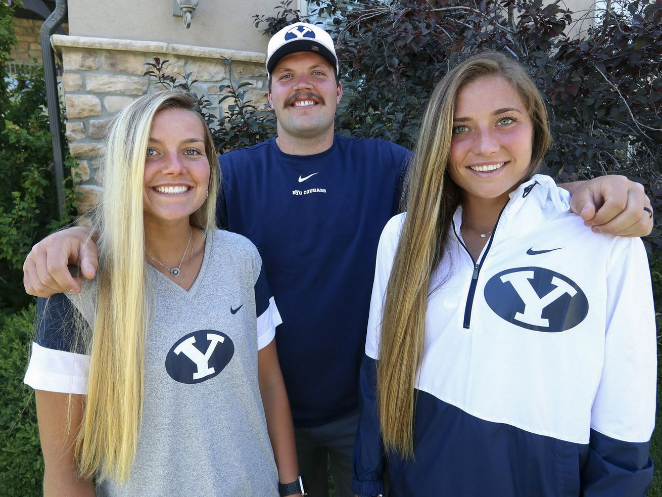 Siblings Savanna, James and Haven Empey pose for a photo outside their home in Lehi on Tuesday, July 7, 2020. All three are BYU athletes. James plays football and Savannah and Haven play soccer.