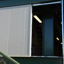 6:10 p.m. Open panel on the north end of the right field video board -