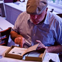 """José Andrés with his signed early edition of Irma Rombauer's """"Joy of Cooking,"""" from which he took some ideas for his menu."""