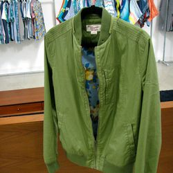 """<a href=""""http://www.originalpenguin.com/"""">Original Penguin</a> surprised with another military green jacket with a floral lining from their Spring collection..."""