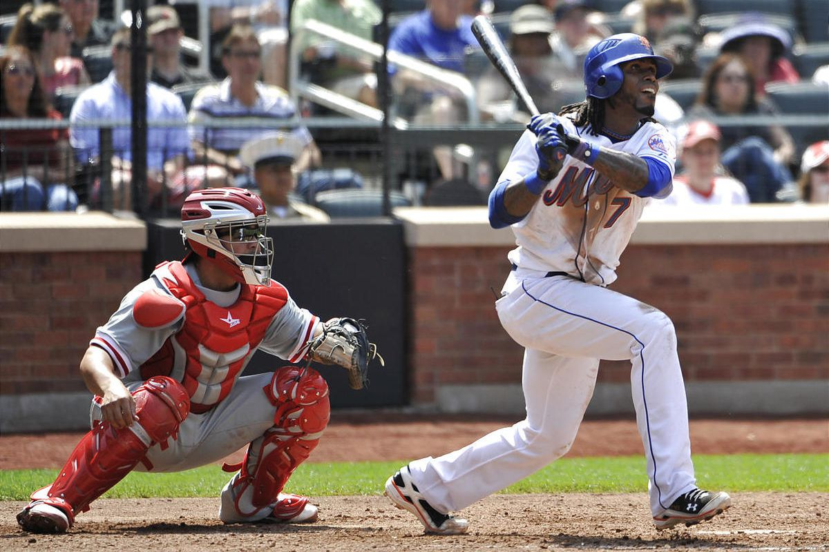New York Mets' Jose Reyes hits an RBI triple off the Phillies' Kyle Kendrick.