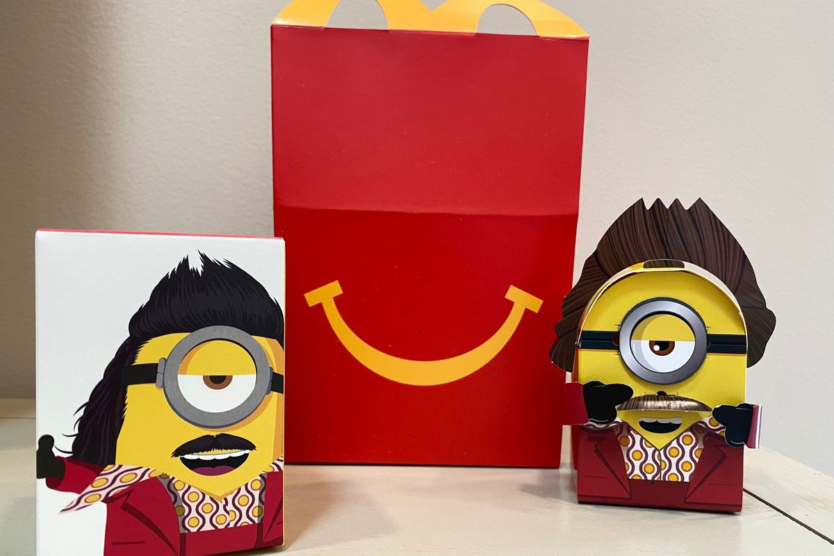 """McDonald's plans to """"drastically"""" reduce the plastic in its Happy Meal toys worldwide by 2025. The company is working with toy companies to develop new ideas, such as three-dimensional cardboard superheroes (pictured) kids can build or board games with plant-based or recycled game pieces."""