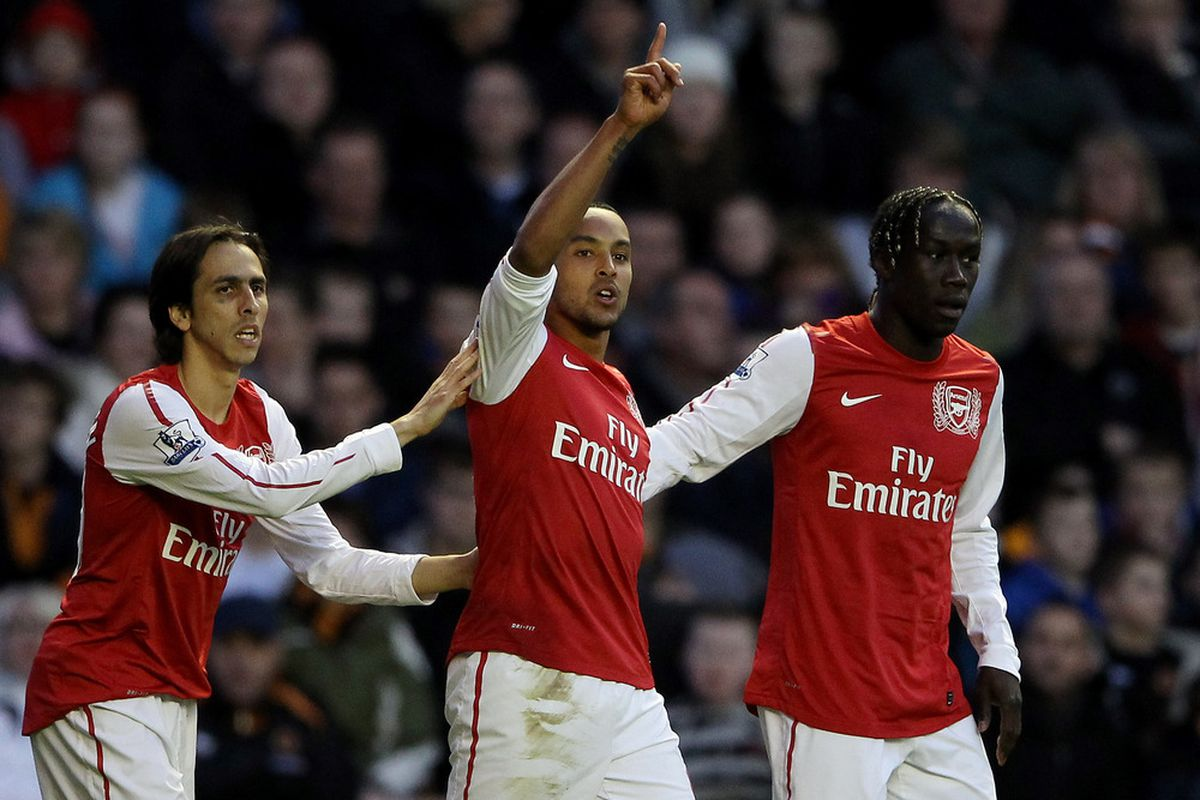 Theo Walcott of Arsenal celebrates after scoring their second goal during the Barclays Premier League match between Wolverhampton Wanderers and Arsenal at Molineux.