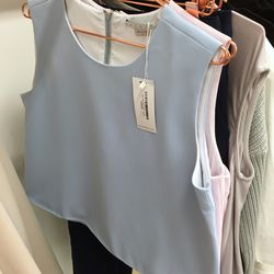 Achro sky high heck shift top, $50 (was $140)