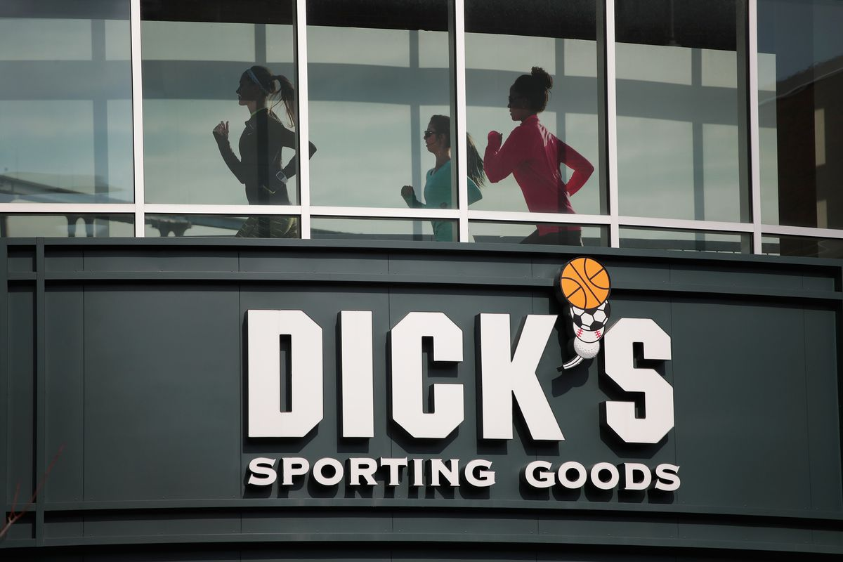 Dick's Sporting Goods store exterior with people seen exercising inside.