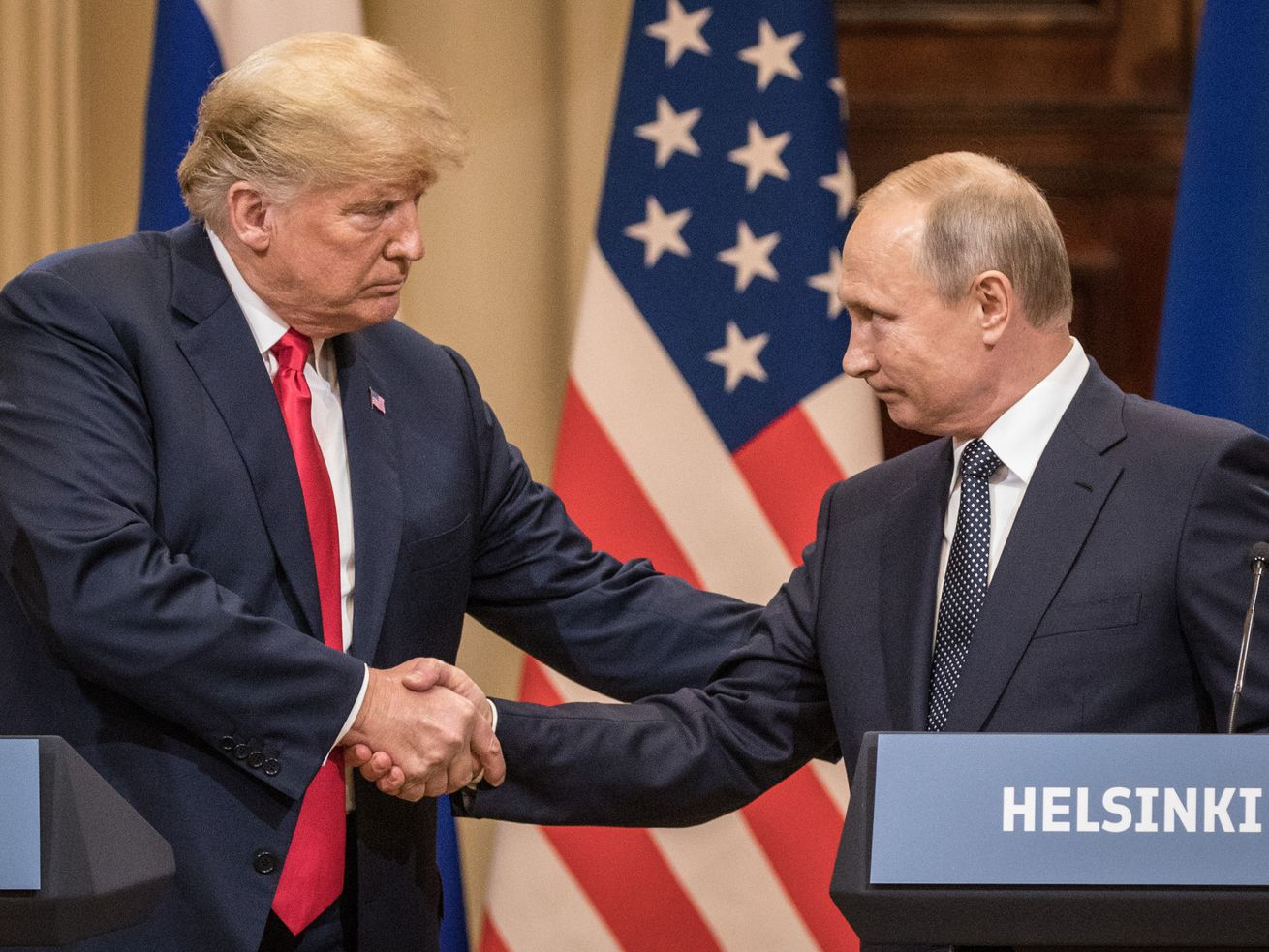 US President Donald Trump (L) and Russian President Vladimir Putin shake hands during a joint press conference after their summit on July 16, 2018, in Helsinki, Finland.