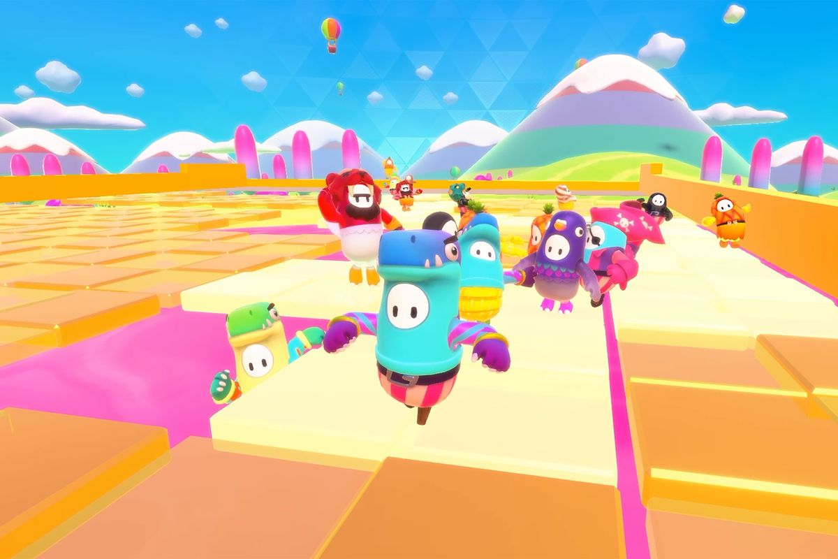 A bunch of beans race in colorful costumes in a screenshot from Fall Guys: Ultimate Knockout