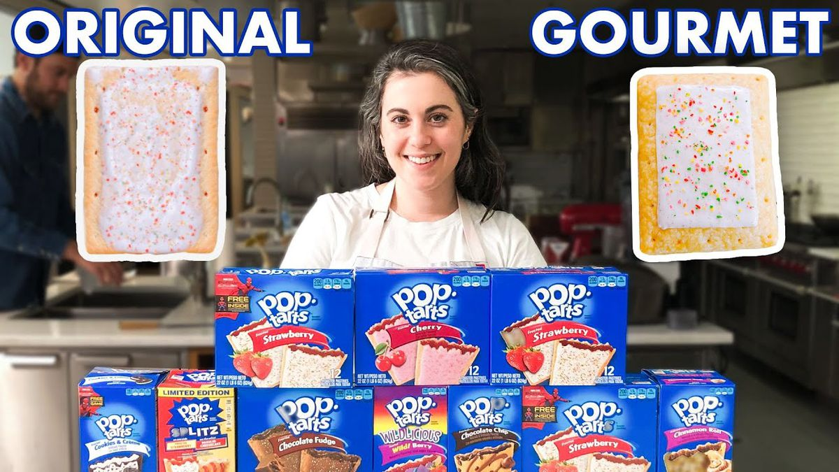 Chef Claire Saffitz stands behind a pile of boxes of Pop Tarts