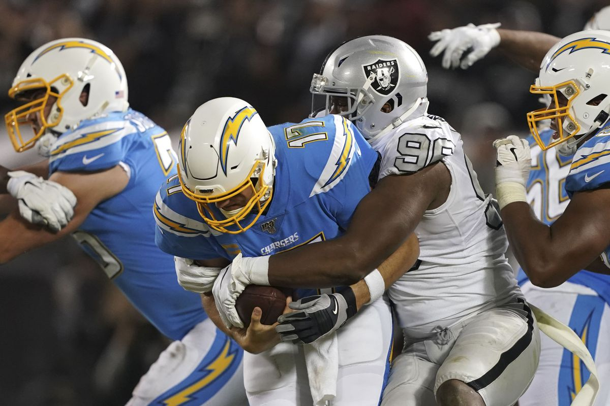 Oakland Raiders defensive end Clelin Ferrell sacks Los Angeles Chargers quarterback Philip Rivers during the fourth quarter at Oakland Coliseum