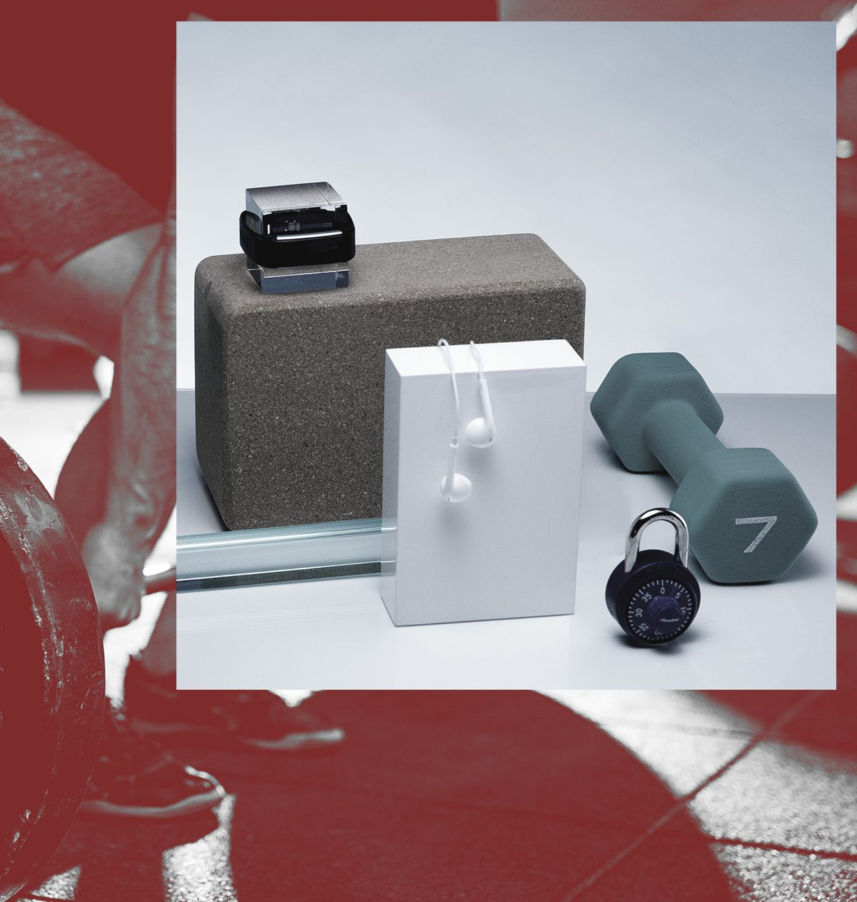 A fitness wearable, earbuds, a handweight and a lock with other wellness products.