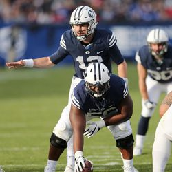 Brigham Young Cougars quarterback Tanner Mangum (12) lines up  in Provo on Saturday, Nov. 12, 2016.