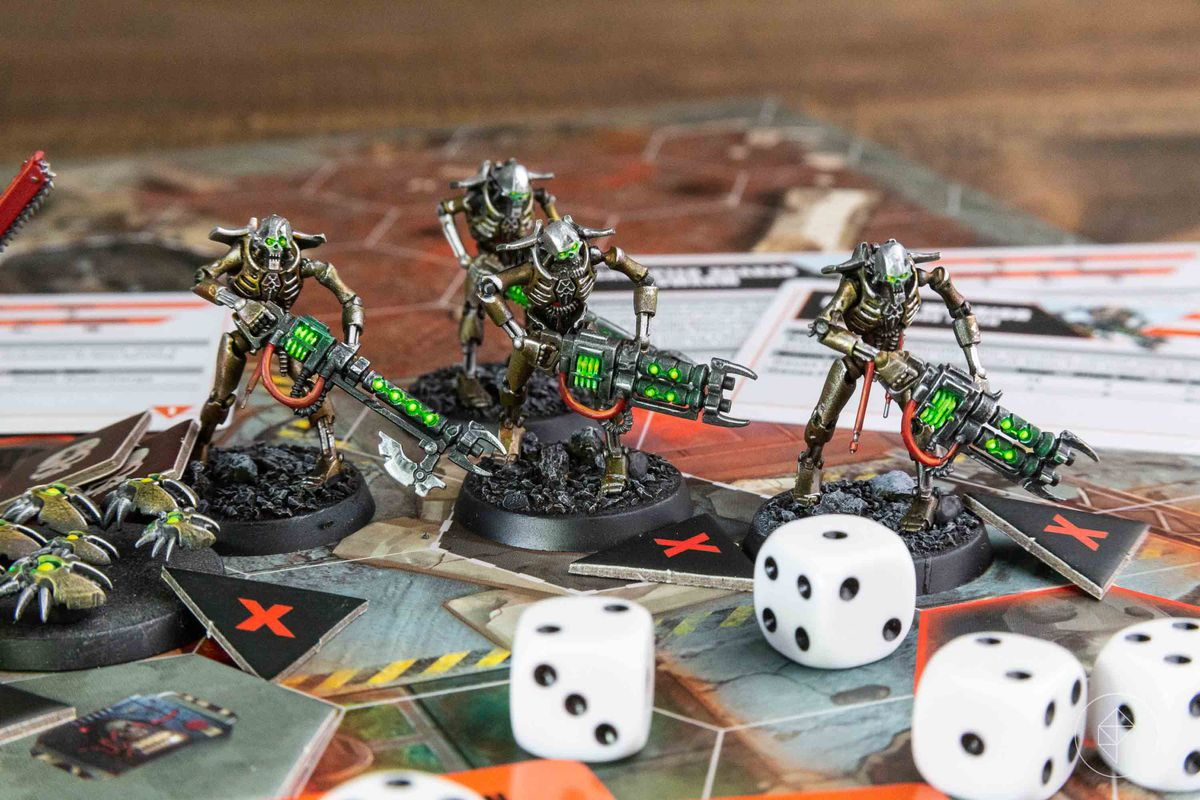 A selection of Necron Warriors, painted a unique gold and chrome coloration.
