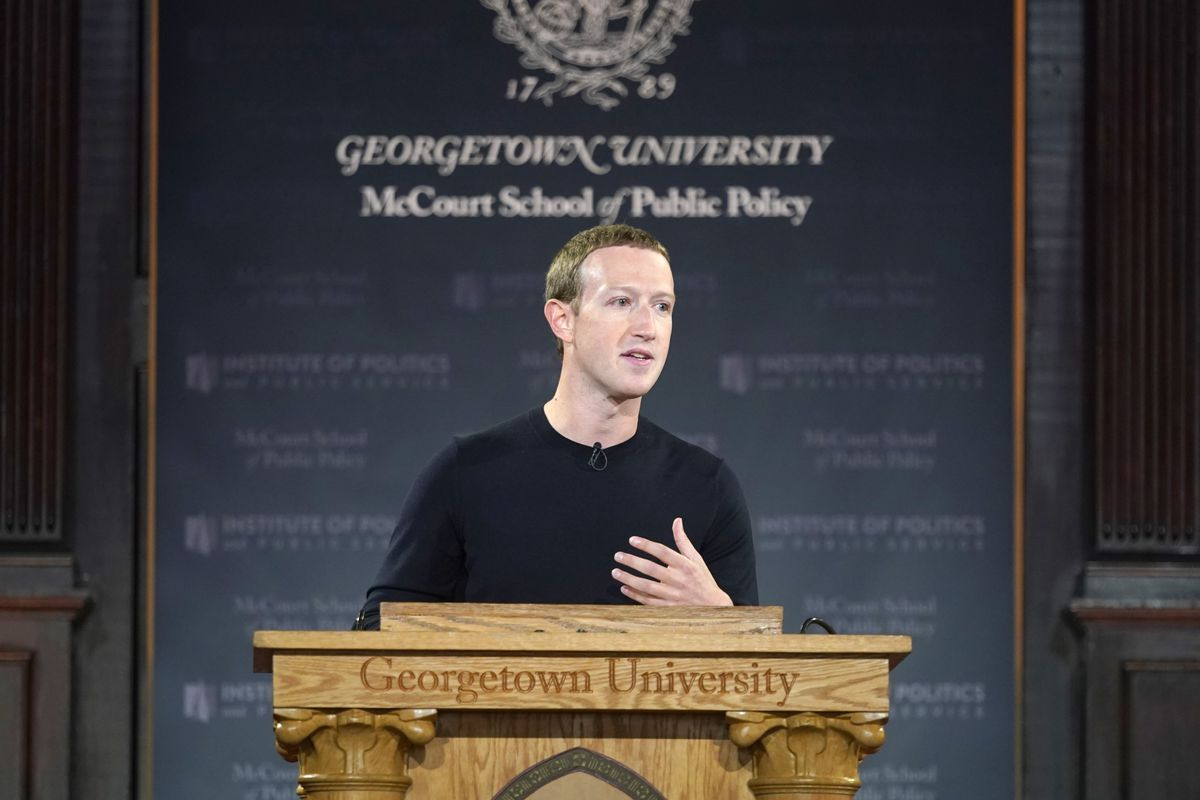 Mark Zuckerberg, standing behind a lectern at Georgetown University, talks about free expression.