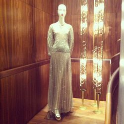 Elegant long-sleeved, long gowns line the store.
