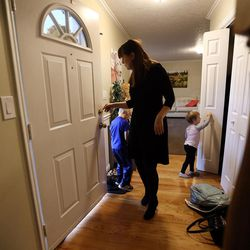 Patricia Abbott Lammi finds jackets as she and her kids Luke and Juliet get ready to leave on Tuesday, May 2, 2017. Patricia and her husband Phillip work to juggle their schedules to make things work with their two kids.