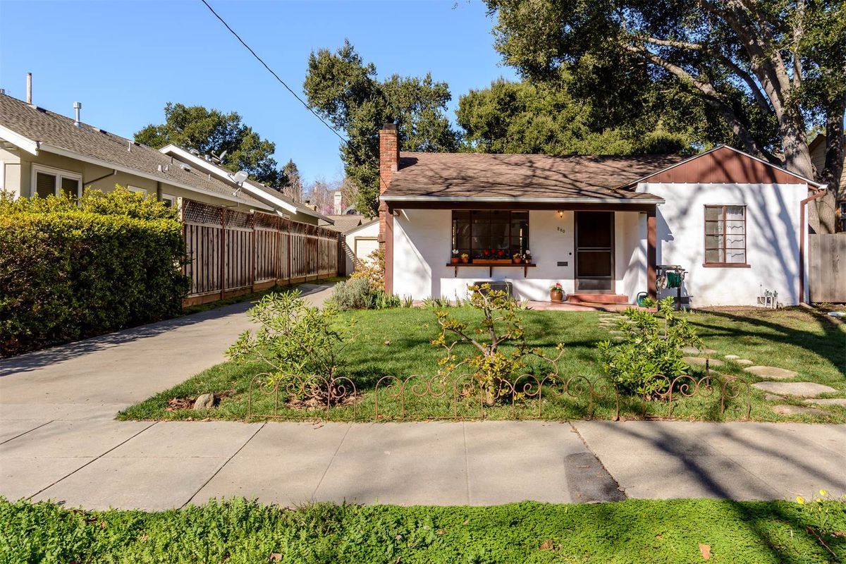 Exterior of old Palo Alto home with large, grassy lot