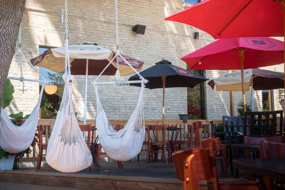 Dangling rope chairs on a large patio