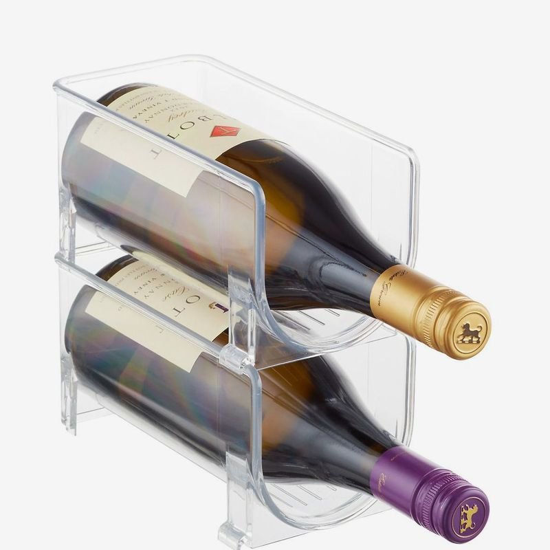 Clear container holding wine bottles.