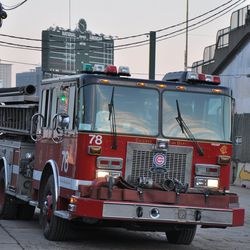 A view of Engine 78 parked on Waveland with the scoreboard in the background