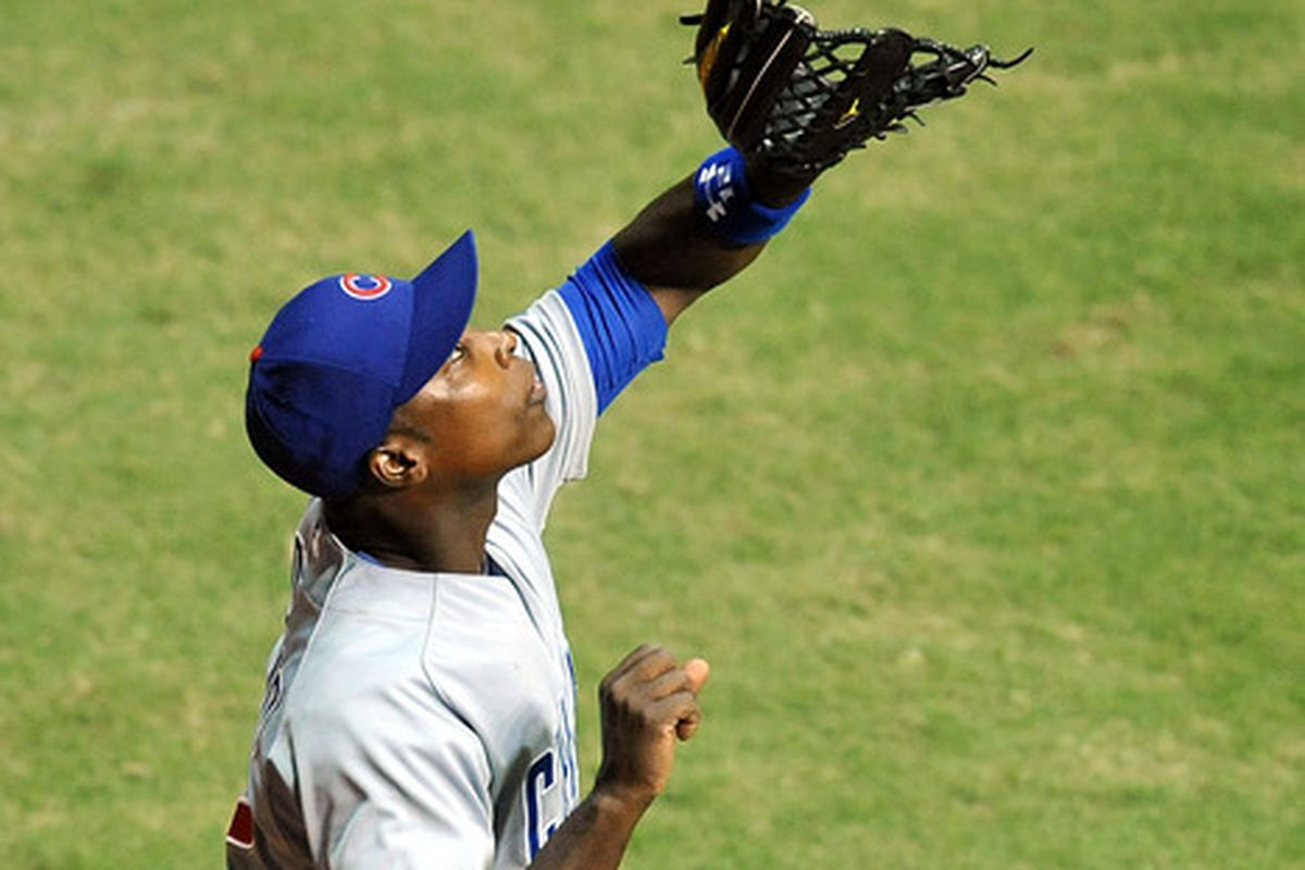 Chicago Cubs left fielder Alfonso Soriano makes a catch in the seventh inning against the Miami Marlins at Marlins Park. Mandatory Credit: Steve Mitchell-US PRESSWIRE