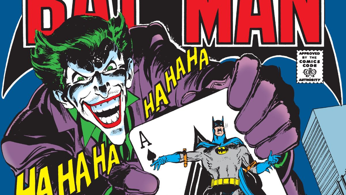 A giant Joker laughs as he holds a giant ace of spades, with a struggling Batman bound to it, on the cover of Batman #251, DC Comics (1973).