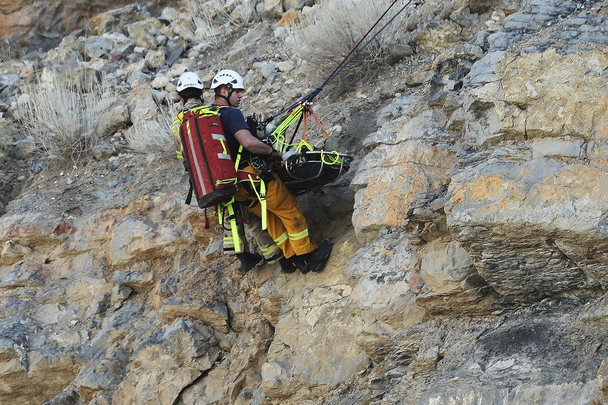 Salt Lake City Fire Department's Heavy Rescue Team aid a 29-year-old man who fell from a cliff in the gravel pit on Victory Road in Salt Lake City on Sunday, Dec. 27, 2020.
