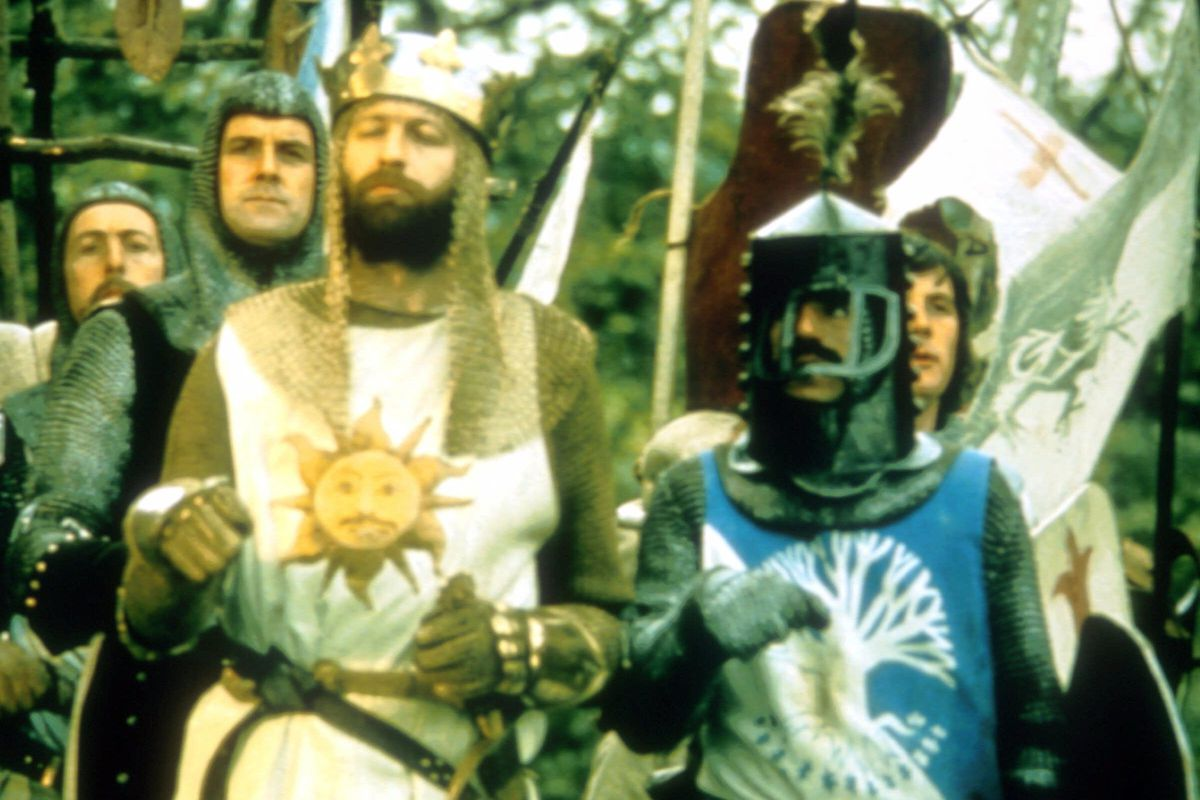 """Terry Jones as Sir Bedevere (in helmet) is perhaps the dimmest knight of the Round Table in """"Monty Python and the Holy Grail."""""""