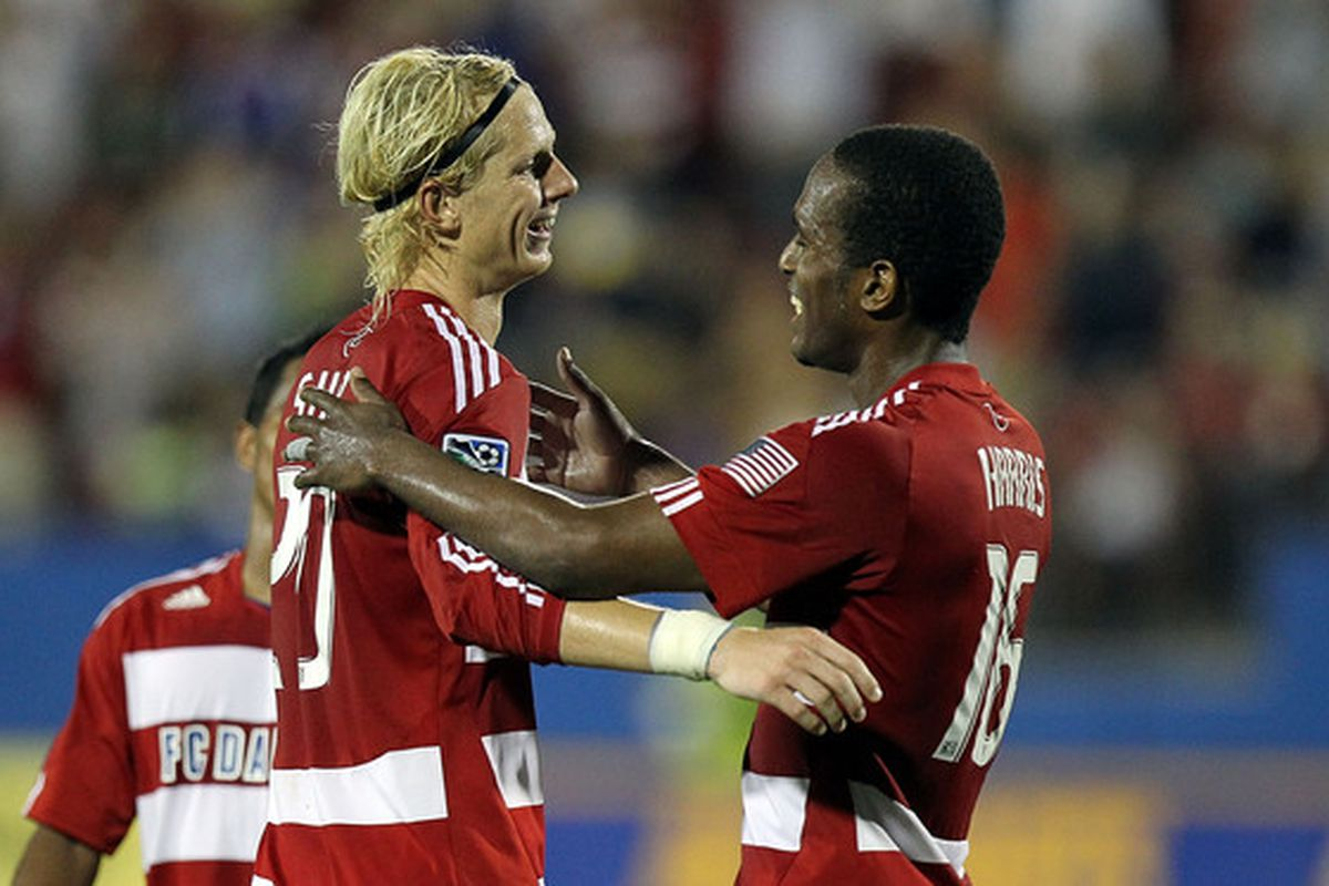 FRISCO TX - JULY 17:  Midfielder Brek Shea #20 of FC Dallas celebrates a goal with Atiba Harris #16 against Real Salt Lake at Pizza Hut Park on July 17 2010 in Frisco Texas.  (Photo by Ronald Martinez/Getty Images)