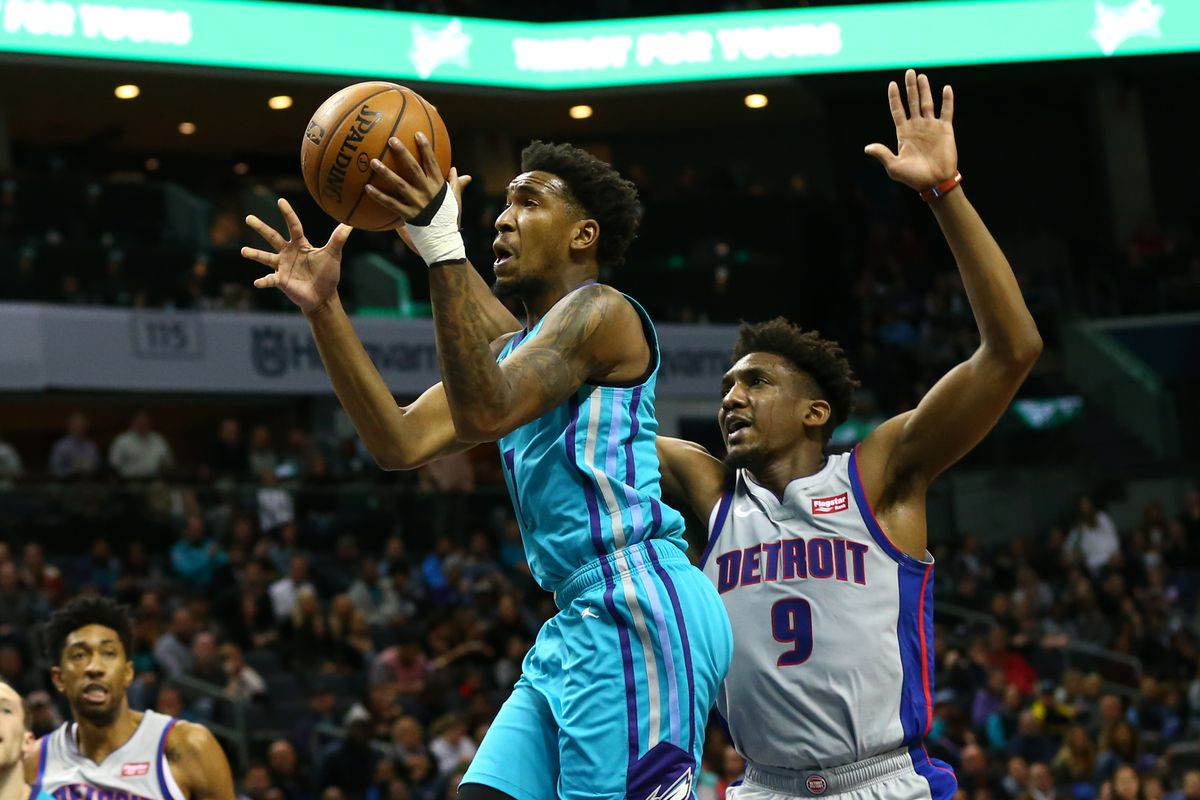 Charlotte Hornets guard Malik Monk goes up for a shot against Detroit Pistons guard Langston Galloway during the second half at Spectrum Center.