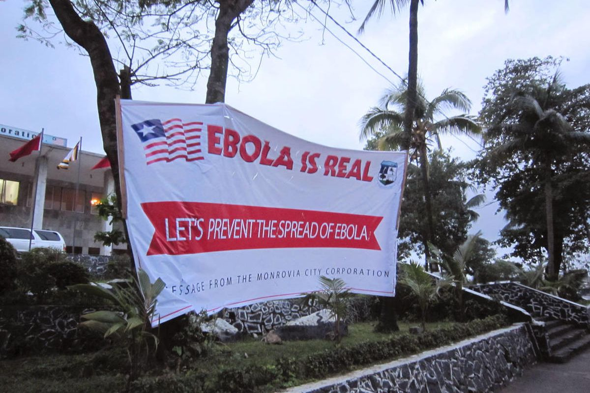 A banner reading 'Lets prevent the spread of Ebola, in front of the city hall in Monrovia, Liberia, Thursday, July 31, 2014. The worst recorded Ebola outbreak in history surpassed 700 deaths in West Africa as the World Health Organization on Thursday anno
