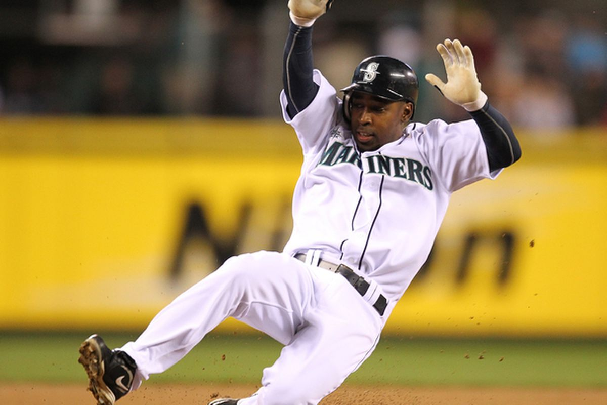 Chone Figgins of the Seattle Mariners slides into third base in the first inning against the Baltimore Orioles at Safeco Field on April 20, 2010 in Seattle, Washington. (Photo by Otto Greule Jr/Getty Images)