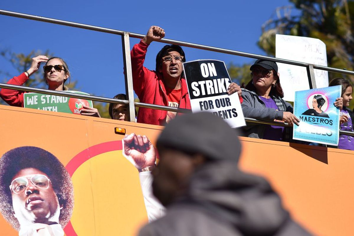Striking public school teachers and their supporters march during the 34th annual Kingdom Day Parade on Martin Luther King Jr Day, January 21, 2019, in Los Angeles, California. (Photo by Robyn Beck / AFP/ Getty Images)
