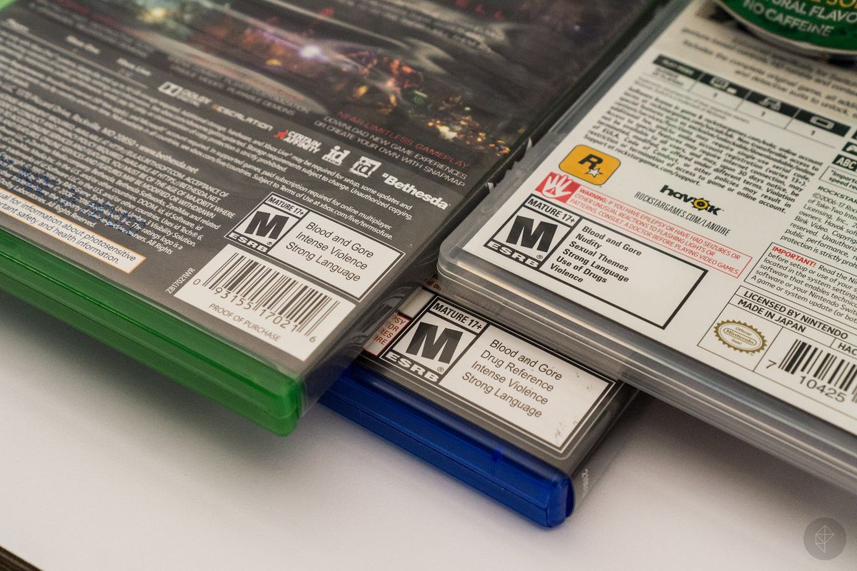 close-up of ESRB M rating on back of three game boxes