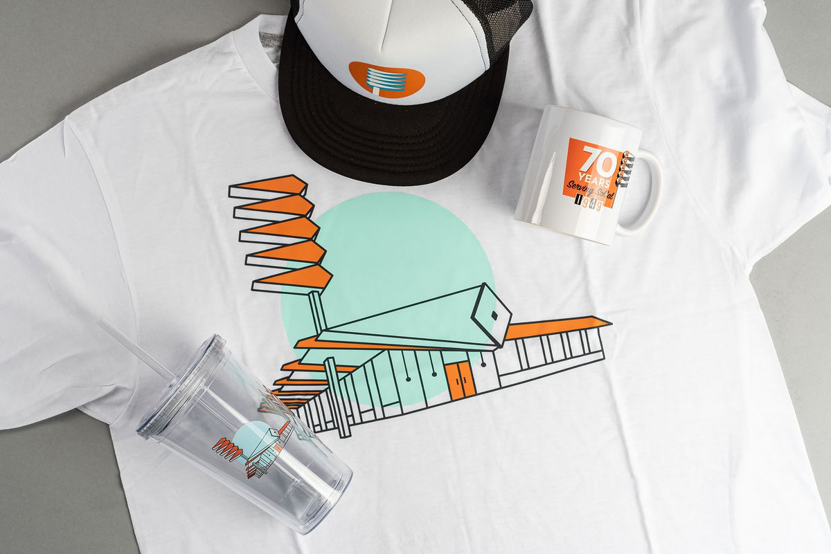 Swag from Norm's, including T-Shirt, hat, cups.