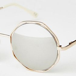 The hexagon details on these gold frames are a fun addition to the classic round shape.