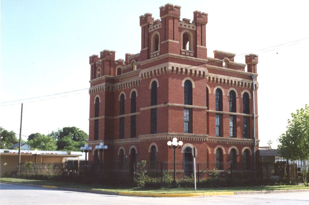 A 1987 photo of a four-story, castle-like building in Brady, Texas.